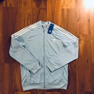 Woman's light blue adidas track jacket size XL